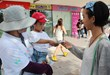 Young boy helped his mother distribute copies of The Way to Happiness August 3, 2013, to forward the purpose of International Friendship Day.