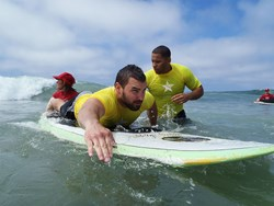 A Veteran surfs the waves at La Jolla Shores during the 6th National Veterans Summer Sports Clinic. Nearly 100 disabled Veterans are participating in the rehabilitation event sponsored by the Department of Veterans Affairs and Veterans Canteen Service.