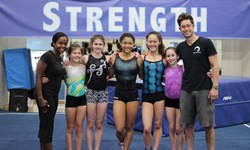 Head coach Katreece Stone and team coach David Seiler with Head Over Heels Athletic Arts athletes to go to the USA Gymnastics National Training Center