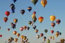 Hundreds of balloons dot the sky over Albuquerque during the Albuquerque International Balloon Fiesta. Photo by Raymond Watt