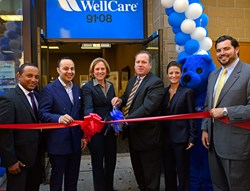 State Assemblyman Francisco Moya and former State Assemblywoman Melinda Katz help John Burke, interim president, WellCare of New York, and other WellCare employees cut the ribbon at the Sept. 20 grand opening of WellCare's Jackson Heights Welcome Room.