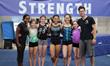 Head coach Katreece Stone and team coach David Seiler with Head Over Heels Athletic Arts athletes to go to the USA Gymnastics National Training Center