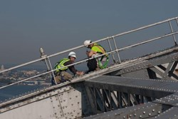 An IIS crew installs sensors on the Bayonne Bridge