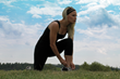 Canadian model Jill Billingsley wearing a black TerraFrog yoga tank and running pants.
