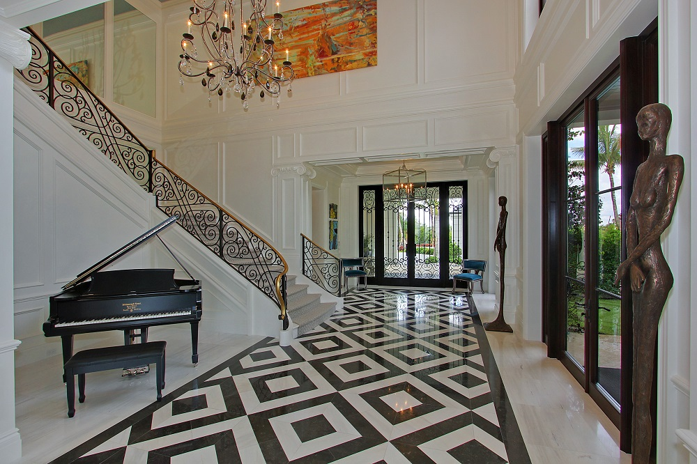 The Signature Tidewater Hall Entry Features Unique Charcoal Grey And White Marble Flooring In A Dramatic Pattern