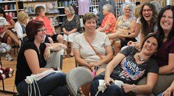 Knitters enjoying Paradise Fibers during a yarn tasting