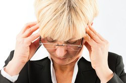 Woman Suffering from Severe and Chronic Migraine Headaches