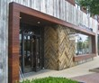 Reclaimed Rail Yard Oak was applied to the exterior entry of a retail store, which opened in August in Georgia, in a traditional herringbone pattern.