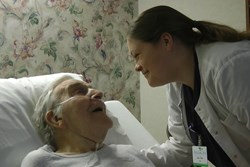 Video still of nurse with patient