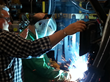 A first-time welder uses the RealWeld Trainer for live evaluation