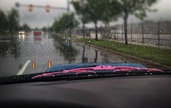 Pink wiper blade on windshield