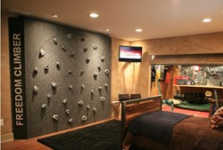 the freedom climber installed in a home build by the crew of extreme makeover home edition illustrates the space saving design of this rotating climbing