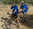 Paul Tyler and David Santamore ride a tandem mountain bike.
