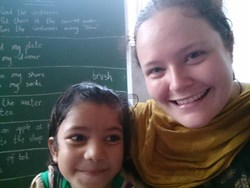 a primary teacher from Aspire People teaching young women and children in india