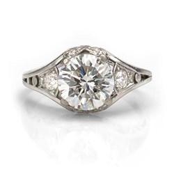 1920's platinum and diamond filigree engagement ring with center diamond.