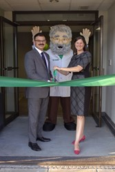 Greg Andon, Libby Haven, and the Gum Guru at the Brass Mill Operations Center for the ribbon cutting ceremony.