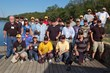 Lynn Reeves (standing left), Lew's CEO, joined the Sept. 2013 class of the FOCUS Marines Foundation near St. Louis, Mo., for their fishing activity.
