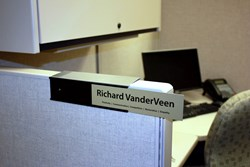cubicle name plate holders easily slide over any cubicle wall