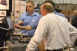 The busy exhibition floor provides opportunities to see new technology up close; above a booth demonstration at SPIE Optifab in 2011.