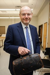 Mark Thompson, President and CEO of The New York Times Company and son-in-law to Dr. Baruch S. Blumberg, presents Dr. Blumberg's medical bag for display at the new Baruch S. Blumberg Institute on Monday at the Pennsylvania Biotechnology Center in Doylesto
