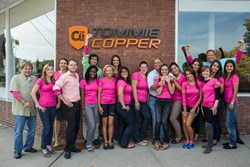 Tommie Copper employees dressed in pink outside of the Tommie Copper retail store