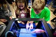 Students check out a 3D printer at Newtown Friends School in Bucks County, Pa. during the launch of a pilot program to support STEM education in U.S. schools.