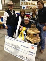 American Royal Association representatives present Grand Champions Darren & Sherry Warth with their winnings.