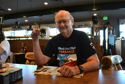 Dick Waterman celebrates his arrival at the Black Bear Diner in Sequim, OR. Photo courtesy of Matthew Nash, Sequim Gazette.