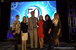 Dr. Donaldson receiving Fast 50 Award