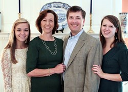 Foxcroft School named Catherine McGehee to lead the presitigious girls' school into its second century. McGehee, pictured here with her husband Read and daughters Eliza and Jane, is a lifelong educator who currently serves as director of St. Cathrine's (R