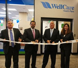 John Burke and Todd Dalrymple of WellCare, Mayor Gerald Jennings and Georgette Steffens of the Downtown Albany Business Improvement District, cut the ribbon at WellCare's Albany Welcome Room.