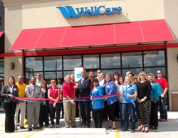 Jim Rich of the Greater Beaumont Chamber of Commerce and Joe Charles of WellCare cut the ribbon at WellCare's Beaumont Welcome Room.