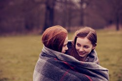 Girls Wrapped In Blanket Outdoors