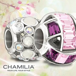 Photo of 2 New Chamilia q$ beads on a A Silver Breeze Background.
