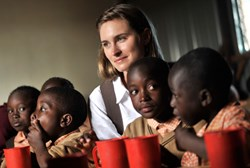 Lauren Bush Lauren with children fed by FEED Projects