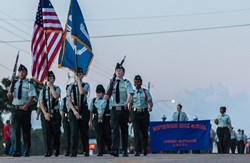 A photo of JROTC groups marching in a parade
