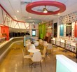The unique interior of Smart Cow Yogurt Bar includes chalkboard tables, one-of-a-kind wall graphics, educational trivia and custom-made toppings dispensers.