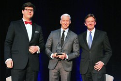 CNN's Anderson Cooper (center) accepts the Wonk of the Year award from American University President Neil Kerwin (right)  and Student Chandler Thornton (left)