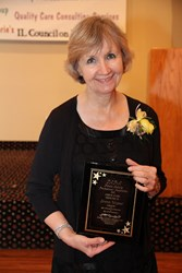 Retirement community activities specialist wins Illinois outstanding professional award.