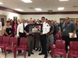 Correctional Counselor Edgar Caraveo presents CCA Florence warden and staff with plaque of appreciation.