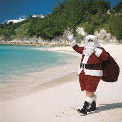 Santa Claus on beach during Christmas in Bermuda