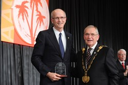 Dr. Gary Parker (left) with AAOMS President Miro A. Pavelka, after receiving the Amercian Society of Oral and Maxillofacial Surgeons 2013 Humanitarian Award.