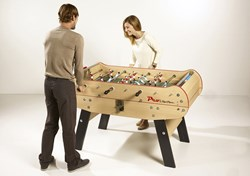 People playing on the new Baby-foot Pro coin operated football table from Rene Pierre