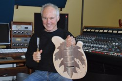 Robert Seagrove uses his grandfathers chisel to carve out a new guitar
