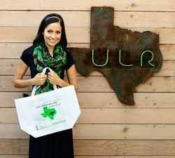 Jessica St. John, managing broker at Urban Leasing & Realty holds Fall Food Drive bag