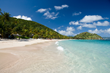 One of Peter Island's five pristine beaches on 1,800 of unspoiled Caribbean island.