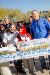 Helen, PJ and Hayden Shafer cut the ribbon to start Walk Now for Autism Speaks: Baltimore