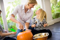 pumpkin carving, celebrate halloween, mom and child carving jack-o-lantern