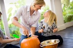 pumpkin carving, celebrate halloween, mom and child carving jack-o-lantern