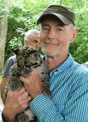 Clouded leopard cubs interact with humans as a way to reduce stress in captivity and improve health and breeding success.